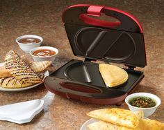 Nostalgia Electrics ENM200 Empanada Maker Makes 2 empanadas at one time Non-stick coating Convenient cord storage Power and preheat indicator lights Product Built to North American Electrical Standards Quick cooking time http://www.amazon.com/Nostalgia-Electrics-ENM200-Empanada-Maker/dp/B008JA3BZY