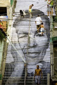 Beautifully Painted Stairs From All Over The World----Rio de Janeiro, Brazil. The detail on these Rio de Janeiro steps are insane. The face looks so life-like and the eyes practically stare straight through you. 3d Street Art, Urban Street Art, Amazing Street Art, Street Art Graffiti, Street Artists, Urban Art, Amazing Art, Awesome, Urban Life