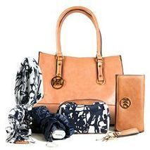 71fba53e00f4c Enter to win the Casey bag in Cognac and 5 piece essentials box from Emilie  M.