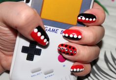 Harley Quinn inspired nail art. Red and black with white polka dots. Accent nail has black polka dots on red and rhinestones.