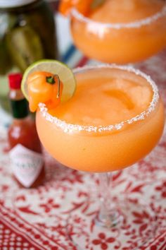 Cajun Margaritas   4 oz. chile-infused tequila (optional)  3 oz. orange liqueur  3 oz. margarita mix  1 tsp. hot sauce  2 cups ice  chile peppers and lime slices, for garnish  salt    For the chile-infused tequila:  5 jalapeno peppers, halved  5 serrano peppers, halved