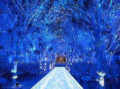 Not technically a tablescape, but I can picture what the tables/room will look like with this as the introduction. (Winter Wonderland ceremony, final design, Preston Bailey)