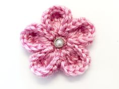 I really love this little free pattern... Used it on a little burlap with a pearl button and it looks adorable!