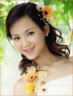 2011 Asian wedding hairstyle with flowers, medium brown hair asian styles.
