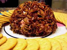 Cranberry Orange Cheese Ball w/ Caramelized Pecans... Set the tone for your holiday festivities with this delicious - and pretty! - appetizer. Part dip, part dessert, you will love the reaction you get when your guests set eyes on this lovely creation.