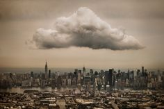 Whenever I'm flying home into LaGuardia Airport, I request a window seat and willfully disobey the flight crew by keeping my point-and-shoot turned on. On this particular September afternoon, there was high cloud cover with one rogue cloud hovering ominously above Midtown Manhattan. I timed this exposure so that you can see straight down 42nd Street, all the way to the Hudson River. Greenpoint, Brooklyn and Long Island City, Queens are visible in the foreground, separated by Newtown Creek.