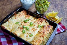 Healthier Chicken Enchiladas... with yummy avocados, no calorie count on this, but i'd gladly skip meals for this