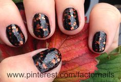 Between fall leaves. Halloween nails.