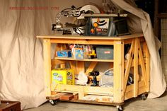 Make a moveable Work Bench from a Shipping Pallet, MDF and Casters.  You could have it working in under an hour!  REDOUXINTERIORS.COM FACEBOOK: REDOUX