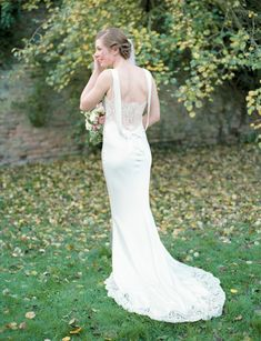 LOVE the detail on the back of this dress. And check out the lace at the bottom, too! A David Fielden Dress for an Elegant Autumn Wedding Photographed on Film
