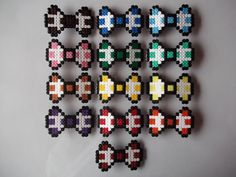 If you are looking for a beautiful bow to adorn your hair or clothes, this may be just the best choice! Made of fuse beads, it can be easily customized to suit your taste and there are many colours available. This listing is for one bow only, so please let me know which one you prefer.  You c...