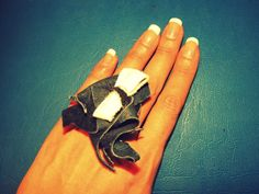 Handmade blue-white leather ring.