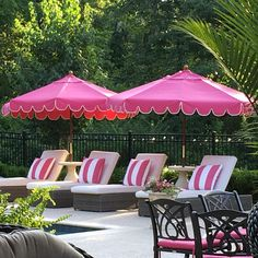 Pretty in pink by the pool. Pink umbrellas, pink & white stripes