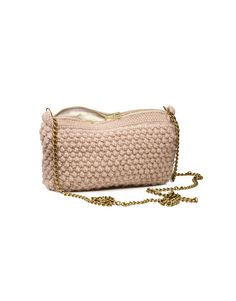 A bubbled and hand knitted shoulder bag. Made by women in the Bolivian highland from the softest baby llama wool. The bag has a thick, textured appearance lined with organic cotton. One inside pocket and a zip closure based on a dense structured chrochet top for long lasting use. The shoulder strap is a brass chain. Size: 14x25 cm