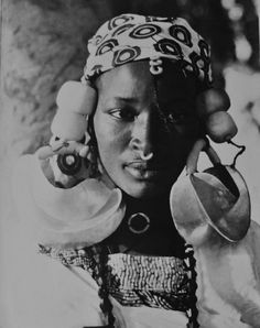 Africa | Fulani woman.  West Africa.  ca. 1950 | Photographer unknown http://www.nomad-chic.com/west-african-pattern-play.html
