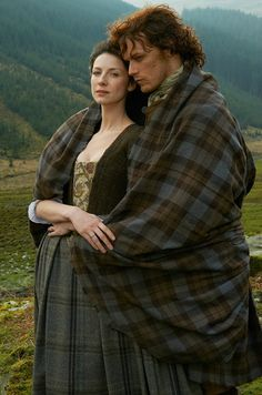 Sam Heughan and Caitriona Balfe as Jamie and Claire Fraser.