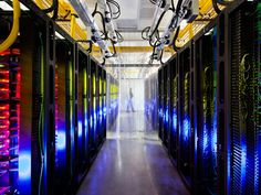 Inside Google's campus network room, routers and switches allow the data centers to talk to each other. The fiber optic networks connecting the sites can run at speeds that are more than 200,000 times faster than a typical home Internet connection. The fiber cables run along the yellow cable trays near the ceiling.