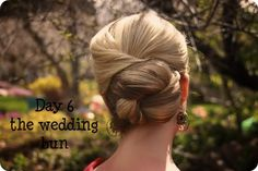 Pull half your hair back, fold it over and pin. Repeat until all hair is off your neck. Gather ends into a bun and pin.
