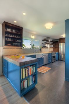 End cabinet or island cookbook storage. The exposed end of a lower cabinet is a great place for sneaking in some cookbook shelf space, as in this example.  Contemporary Kitchen by brio interior design