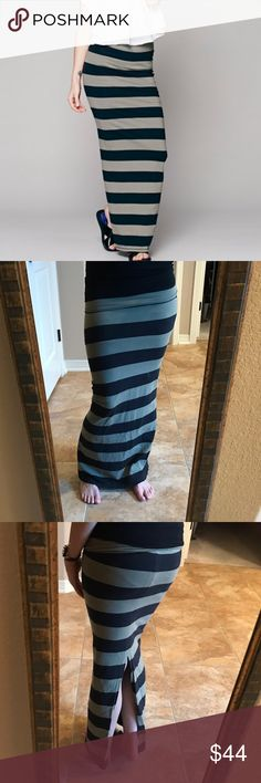 """Free People Slit Back Rugby Column Maxi Skirt Free People Rugby Stripe Column Skirt, Slit Back Maxi Skirt. Stretchy horizontal striped maxi skirt with slit at lower back. Body-conscious, flattering fit. Super sexy and chic! Can be rolled over to adjust length (overall 40.5""""). Black and olive green wide stripes. Excellent piece! May be able to double as a strapless dress too! Free People Skirts Maxi"""