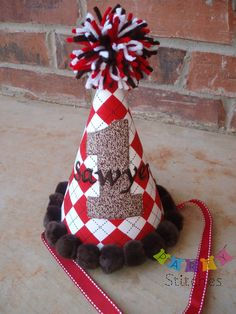 Red Argyle Sock Monkey Birthday Party Hat. $24.50, via Etsy.