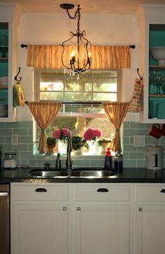 love the random chandelier in the kitchen - she got it at Ikea...