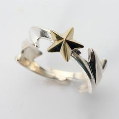 Thunder and lightning!  Uniquely crafted silver ring a brass lucky star shining on top.    #handmade #ring #fashion