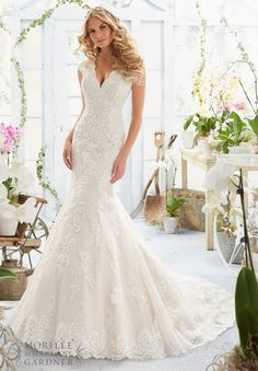 Wedding Dress 2806 Crystal Beaded Embroidered Appliques and Scalloped Hemline on a Net Gown with Sheer Train