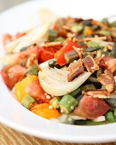 """Sauteed Okra with Heirloom Tomatoes and Bacon - Scott Peacock and Edna Lewis, authors of """"The Gift of Southern Cooking,"""" share their wonderful sauteed okra recipe paired with heirloom tomatoes and bacon, which is a great dish to serve at any summer get-together."""