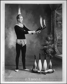 J. T. Doyle with fire. ca. 1902 - Flaming Indian Clubs