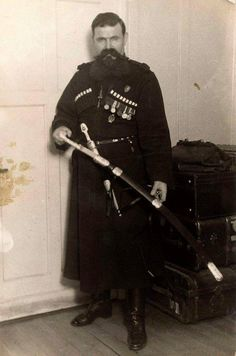 "Timofey Ksenofontovich Yaschik,Cossack bodyguard firstly to Tsar Nicholas ll of Russia,then his mother,the Dowager Empress Marie Feodorovna of Russia.He was able to escape from Russia,accompanying the Empress to Denmark.  ""AL"""