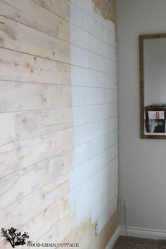 Plank Wall Tutorial by The Wood Grain Cottage - laundry room wall - add hooks to hang bags