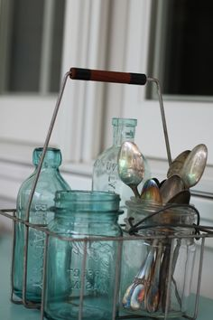 Vintage Milk Carrier with antique bottles & silverware. Can you for display or practical purposes. Love it!