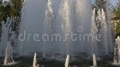 Fountain - gushing jets in sunlight.