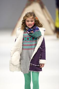Madrid-based Boboli, sent Ethnic, a collection for fall-winter 2015 inspired by the wild west, down the FIMI runway. Wearing American Indian-influenced accessories, the models showed garments in Technicolor brights and various washes of dark denim. Knits and crocheted pieces, such as the girl's blanket-patterned tunic and fleece-lined topper, are important. www.lccollectionsltd.com, www.boboli.es (designer preview)