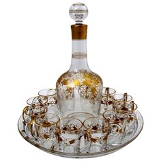 1870s French Gold Enamel Crystal Baccarat Liquor Service 14 pc Vine leaves | From a unique collection of vintage enamel frames and objects at https://www.1stdibs.com/jewelry/objets-dart-vertu/enamel-frames-objects/