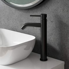 Stylish Matt Black tall basin mixer tap Matching slotted clicker waste included Coolstart ceramic disc technology Made from solid brass 10 year manufacturers guarantee