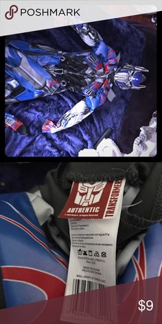 Optimus Prime auto bots transformer costume Fits 35/45lbs. 2piece (bodysuit and face mask) it says medium but most 7/8 year olds would be too big for this. Costumes Halloween