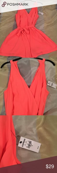 NWT Express Neon Coral Silk Romper NWT NEVER WORN. Super cute spring/summer romper. Lightweight flowy silk. Double v neck. Silk tie around waist. Size 0. Bought for my honeymoon and never worn it. Just sitting in my closet. Express Dresses