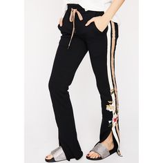 Embroidered Stripe Track Pants ($65) ❤ liked on Polyvore featuring activewear, activewear pants, black, embroidered sportswear, track pants and floral activewear