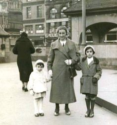 March 1933 : The last picture taken of Anne, Edith, and Margot Frank in Germany, prior to emigrating to Netherlands.  Anne Frank is 3 years, 9 months old. They are standing in the Hauptwache square in the center of Frankfurt am Main.