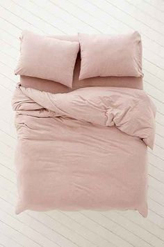 bedroom or dorm room an oasis with colorful duvets, comfortable sheets and decorative tapestries from Urban Outfitters. Shop our bedding collections.