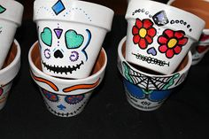 """These 4"""" hand-painted terra cotta pots will bring some kitsch into your garden. For the non-gardener, they could be used as a pen holder or catch-all, and even in the kitchen! They have been sealed to protect from water damage and preserve the art work. Each piece is made to order and one of a ki..."""