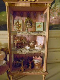 Miniature Child's Book-Shelf with collectables. 1/12 scale.