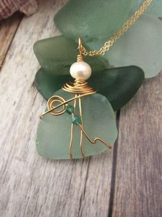 A personal favorite from my Etsy shop https://www.etsy.com/listing/561473829/sea-glass-wire-wrapped-with-pearl
