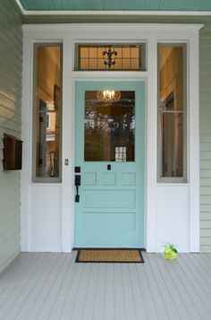 The front door was found at a salvage yard. Mattison paid $150 to patch and paint it.    Door paint: Hazel, Sherwin-Williams