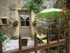 private stone-walled patio with private entrance to unit