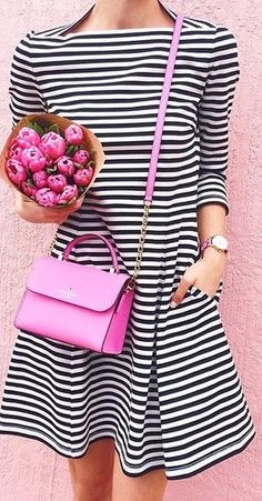 Striped dress matches perfectly with this hot pink bag