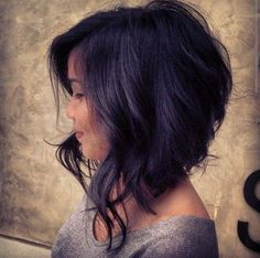 34 Curly Bob Hairstyle Ideas: ANGLED BOB WITH BEACHY WAVES