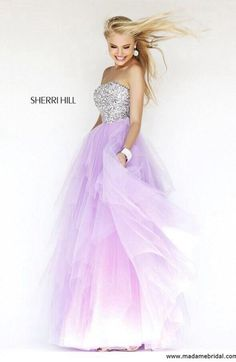 Glam long purple Sherri hill prom dress with float skirt and strapless crystal bodice